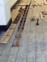 Replacement of screwed floorboards during restoration process