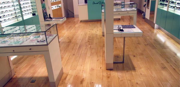 Restoration of the wood floor in a retail unit.