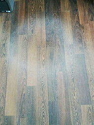 cloudy white spot on hardwood floor